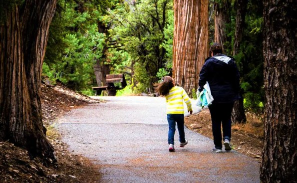 A woman and a child hiking in the woods
