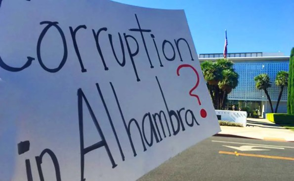 A sign in front of Alhambra city hall