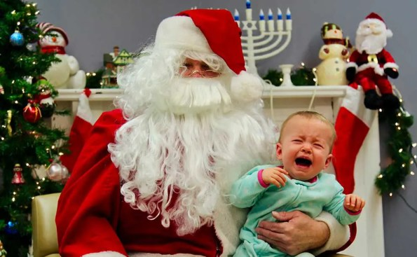 Santa with a crying baby on his lap