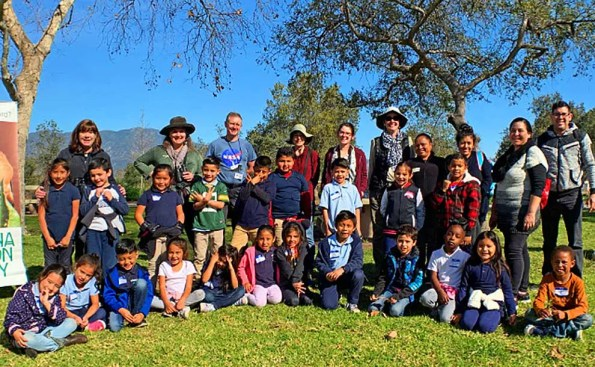 students and docents on a field trip