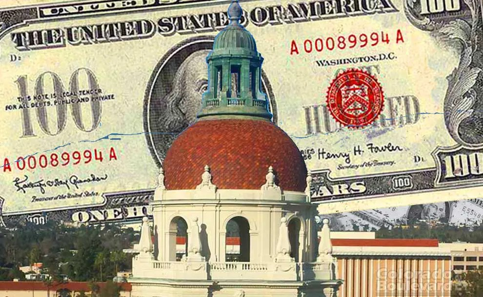 A red brick dome with $100 bill behind it