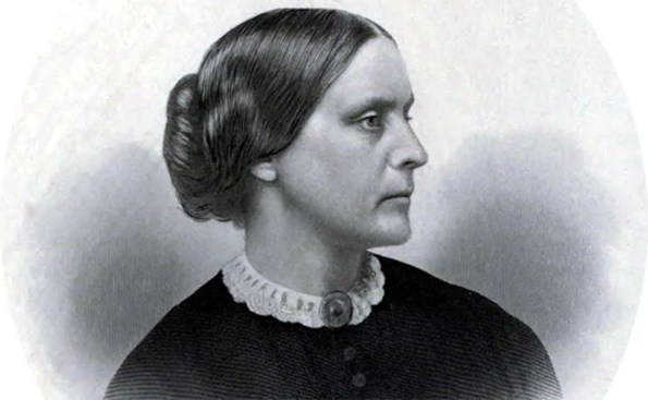 A black and white of a woman with short tucked hair