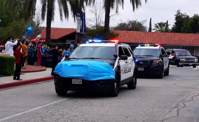 A police car outfitted with a blue mask