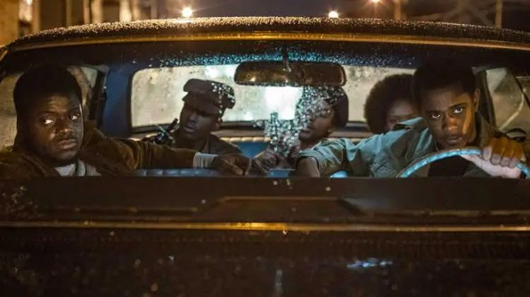 black men in a car while raining