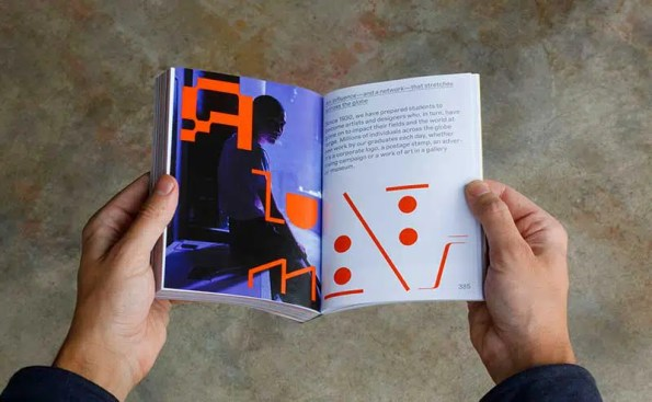 hands holding an open book