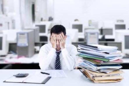 Frustrated man behind stacks