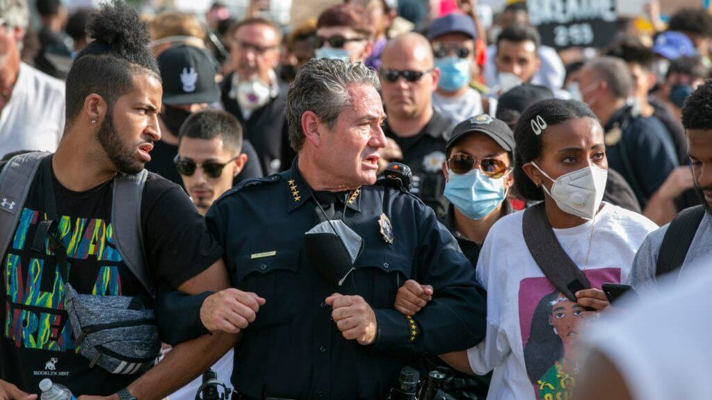 Denver Police Chief Paul Pazen marches and speaks with demonstrators on Monday, June 1, 2020, as they peacefully protest the death of George Floyd at the hands of Minneapolis police. (Hart Van Denburg/CPR News)