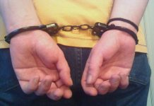 """Handcuffed arrested"" by Whitesun12 via Flickr: Creative Commons"
