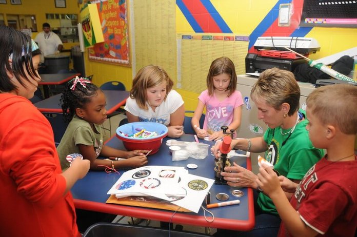 Children make buttons in an after-school program. (Photo by Fort Rucker via Flickr:Creative Commons)