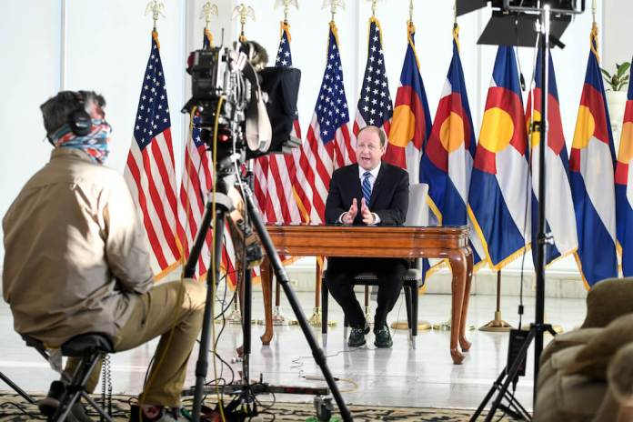 DENVER, CO - APRIL 6: Colorado Governor Jared Polis delivers an address from the governor's mansion on Monday, April 6, 2020. Polis said that the state of Colorado will extend a statewide stay-at-home order from April 11 to April 26 due to coronavirus. (Photo by AAron Ontiveroz/The Denver Post)