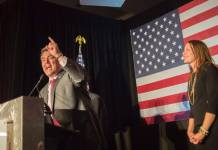 U.S. Sen. Cory Gardner celebrates the election of Donald Trump on Tuesday, Nov. 8, 2016 as his wife, Jaime, looks on. (Photo by Evan Semón)