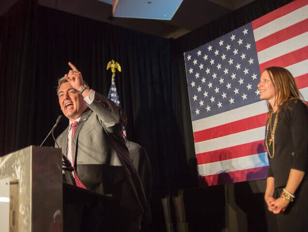 U.S. Sen. Cory Gardner celebrates the election of Donald Trump on Tuesday, Nov. 8, 2016 as his wife, Jaime, looks on. (Photo by Evan Semón)