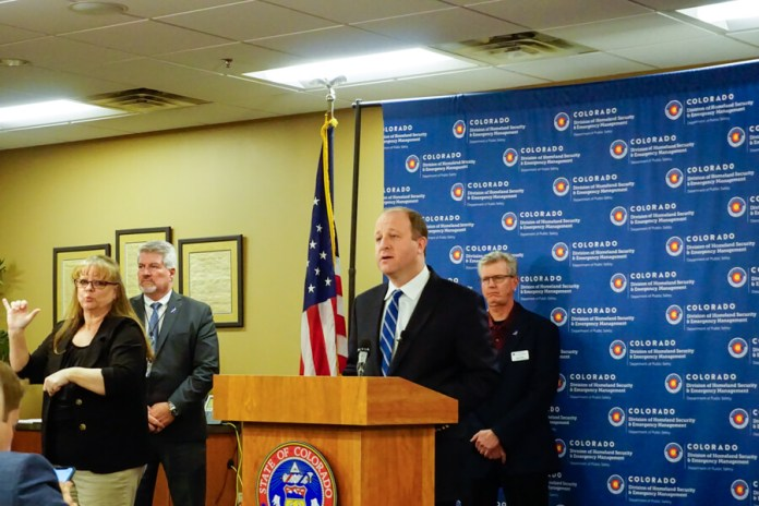 Gov. Jared Polis announces a stay-at-home order for Colorado at the Emergency Operations Center in Centennial on March 25, 2020. The order goes into effect Thursday through April 11, 2020. (Photo by Forest Wilson)