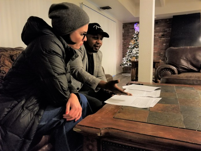 Congolese community leader Martin Masimango chats about his speech on Denver's East Area Plan with another member of the East Colfax Community Collective at a East Colfax neighborhood apartment complex on Nov. 21, 2019. (Photo by Forest Wilson)