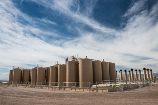 A Crestone Peak oil and gas operation on County Line Road on the Weld County side. The site contains 16 wells, 40 oil tanks, 26 combustors, 17 separators. (Photo by Ted Wood/The Story Group.)