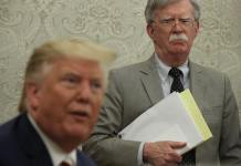 WASHINGTON, DC - AUGUST 20: U.S. President Donald Trump speaks to members of the media as National Security Adviser John Bolton listens during a meeting with President of Romania Klaus Iohannis in the Oval Office of the White House August 20, 2019 in Washington, DC. This is Iohannis' second visit to the Trump White House and the two leaders are expected to discuss bilateral issues during their meeting. (Photo by Alex Wong/Getty Images)
