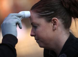 WASHINGTON, DC - MARCH 16: Workers from the White House Physician's Office check the body temperatures of people entering the White House with a forehead temperature scanner on March 16, 2020 in Washington, DC. The White House is now routinely checking the temperatures of people who may be in close contact with President Donald Trump or Vice President Mike Pence as efforts to contain the COVID-19 virus continue. (Photo by Win McNamee/Getty Images)