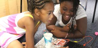 Students Maliah and Kayla at the Imaginarium's Summer Lab camp at Columbine Elementary School. (Photo by Susan Gonzalez)
