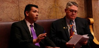 Democratic Senate President Leroy Garcia, left, and GOP Minority Leader Chris Holbert chat on Thursday, May 2 — the second-to-last day of the 2019 legislative session. (Photo by Alex Burness)