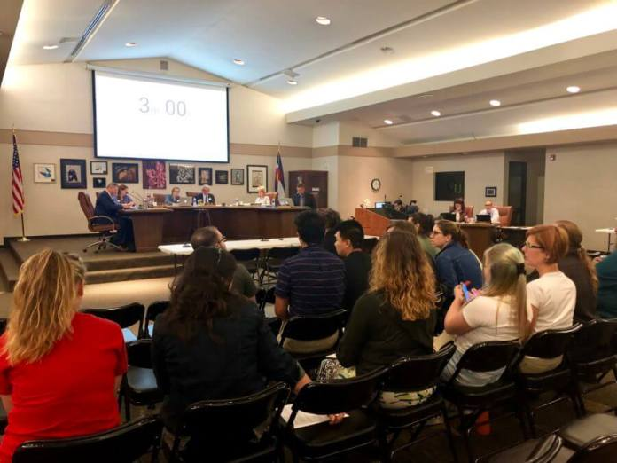 Teachers, parents, and students wait to speak in favor of updating LGBTQ policies at a recent Jefferson County School Board meeting Thursday. (Photo by Kati Weis, Chalkbeat Colorado)