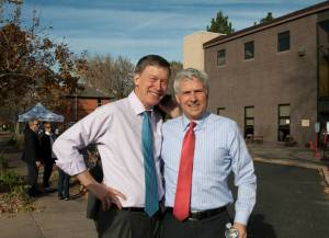 Gov John Hickenlooper and CU Regent Michael Carrigan greet voters outside a voting service center in Capitol Hill.