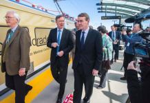 Hickenlooper, left, and Sen. Michael Bennet — pictured here at the 2016 opening of RTD's A-Line — will join the Democratic primary debate on June 27, 2019 (Photo by Evan Semón)