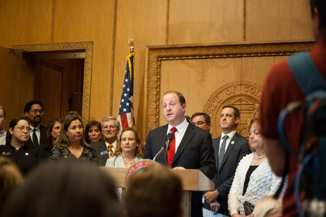 Gov. Jared Polis signed SB-181, a landmark bill overhauling the state's oil and gas regulations, into law on April 16, 2019. (Photo by John Herrick)