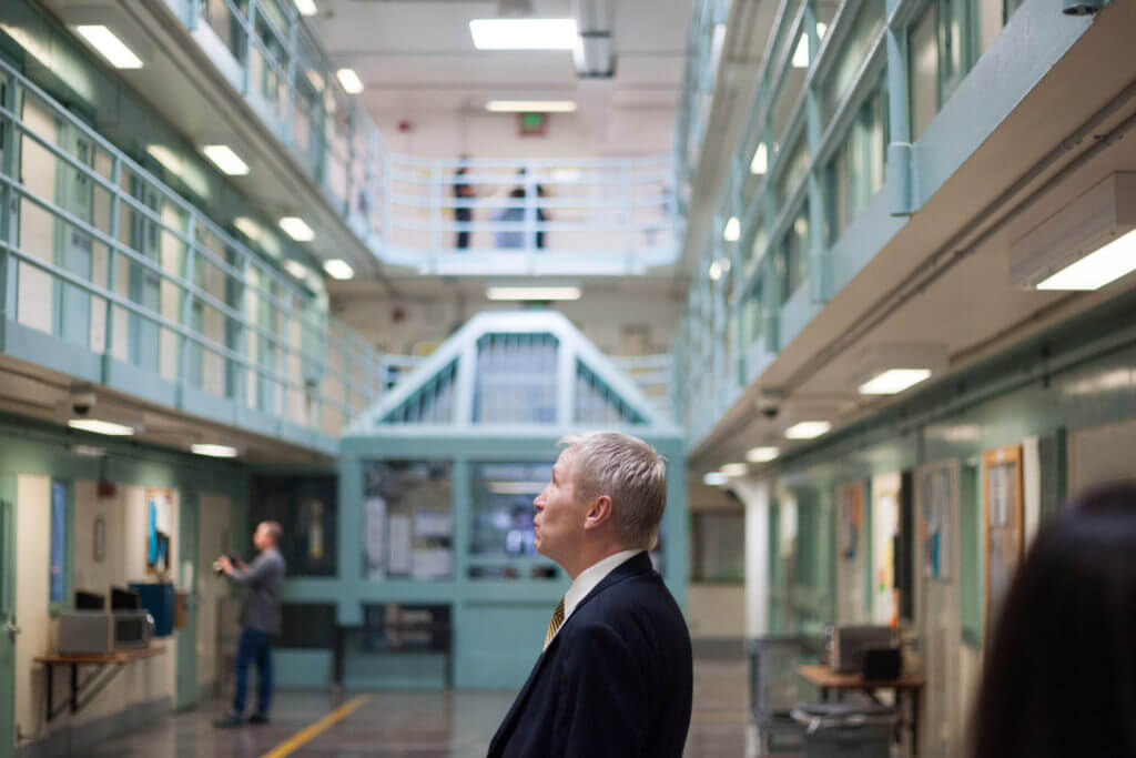 Dean Williams, director for the Department of Corrections, speaks to an inmate at the Fremont Correctional Facility in Cañon City on July 19, 2019. (Photo by John Herrick)