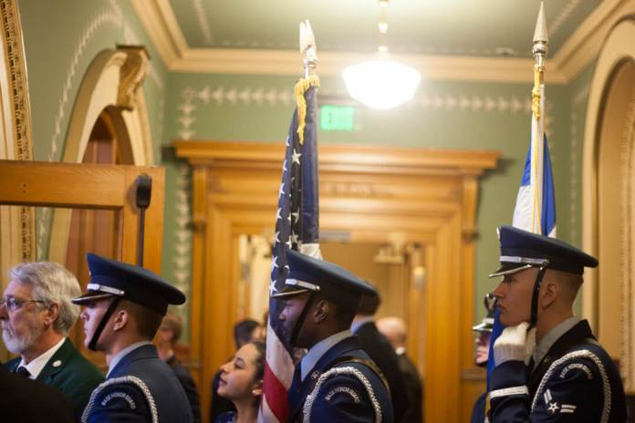 The honor guard prepares to enter the House chamber on the opening day of the 2020 Colorado legislative session on Jan. 8. (Photo by John Herrick)
