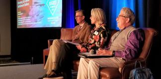 County Commisioners John Kefalas (right) and Hilary Cooper, and substance abuse expert Rob Valuck (left), prepare to speak about divvying up opioid settlement dollars at the Hilton Denver Inverness Hotel on Dec. 5, 2019.