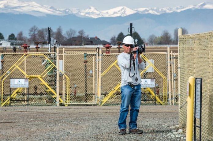 Patrick Murphy, Boulder County Public Health employee, uses a FLIR infrared camera to check for gas leaks at a Crestone operating well pad in eastern Boulder County. (Photo by Ted Wood/The Story Group)