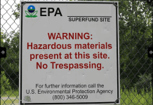 Warning sign posted at contaminated Superfund site. (Photo via EPA.gov)