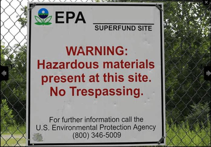 Warning sign posted at contaminated Superfund site. (Photo via EPA.gov)