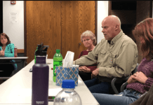 Roy Kinney speaks during the community meeting in Rangely. To his left is Debra Pierce. To his right is Sharon Raggio, CEO of Mind Springs Health.