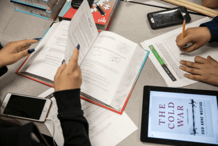 Noel Community Arts School students work through assigned classwork during a study period at the Denver school in May 2019. (Nathan W. Armes/Chalkbeat)
