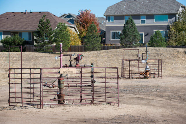 Older vertical wells 200 feet from homes next to Silver Creek Elementary School in Thornton, Colorado. (Photo by Ted Wood/The Story Group.)