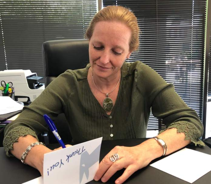 "Colorado Democratic Party Chair Morgan Carroll issued a photo of herself sending a ""thank you"" to Rep. Ken Buck on Wednesday."