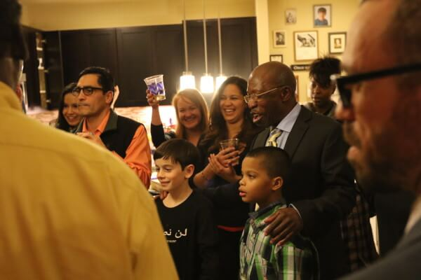 Surrounded by his grandchildren and legal team, Moses-EL celebrates freedom.