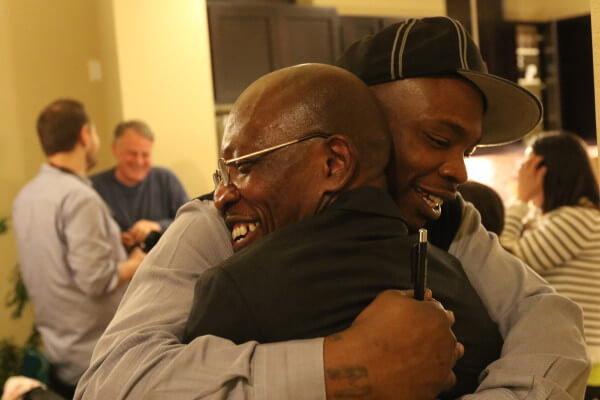 Moses-EL and his son Burke embrace. Photo: Greg Hoenig