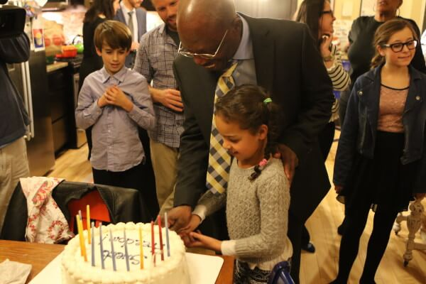 A taste of sweet freedom. The cake had 12 candles, one for each grandchild Moses-EL had not met in his 28 years in prison. Photo: Greg Hoenig