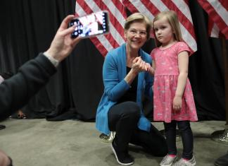 Sen. Elizabeth Warren (D-MA) poses for a selfie and a pinkie promise ahead of her Super Tuesday night event on March 03, 2020 in Detroit, Michigan. She dropped out of the race two days later after a poor showing in which she failed to win even her own home state. (Photo by Scott Olson/Getty Images)