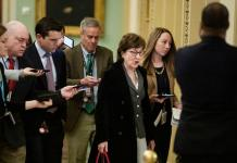 WASHINGTON, DC - JANUARY 30: Sen. Susan Collins (R-ME) is trailed by reporters as she at the U.S. Capitol before the Senate impeachment trial of President Donald Trump on Capitol Hill on January 30, 2020 in Washington, DC. Collins has stated she wants to hear from witnesses in the trial. (Photo by Samuel Corum/Getty Images)