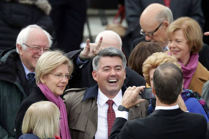 (L-R) Sen. Elizabeth Warren (D-MA), Sen. Bernie Sanders (D-VT) and Sen. John McCain (R-AZ) pose or a photo around Sen. Cory Gardner (R-CO) as they arrive on the West Front of the U.S. Capitol on Jan. 20, 2017 in Washington, DC. for the inauguration ceremony of Donald J. Trump. (Photo by Chip Somodevilla/Getty Images)