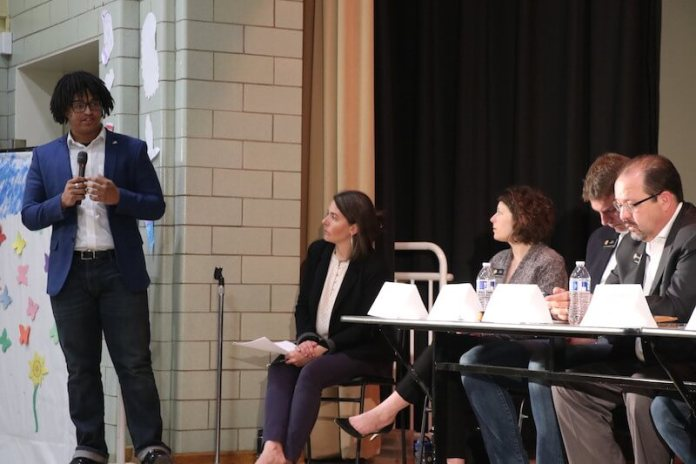 Recent Denver Public Schools graduate Charlie Jones tells a panel of lawmakers and district officials that adding more school resource officers is not a solution to school shootings. It creates its own problems, he said at the gathering May 29, 2019 in Denver. (Photo by Grace Carson)