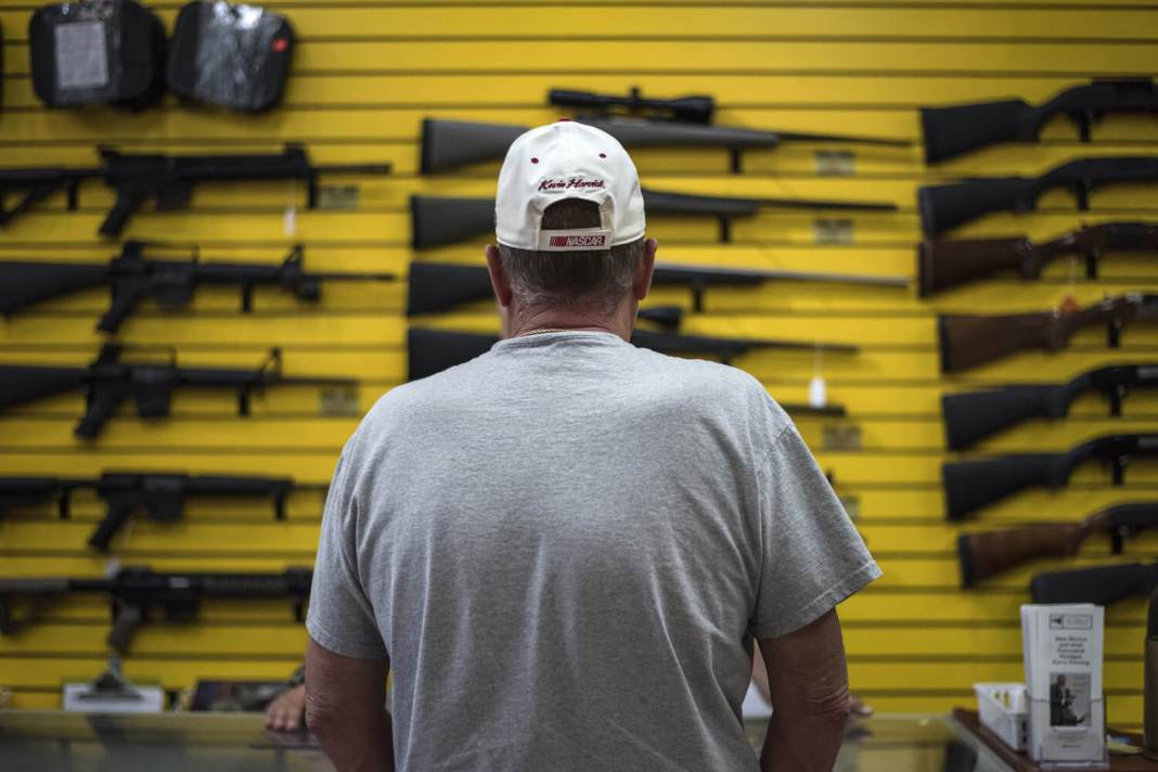 A customer at ABQ Guns in Albuquerque. Recent mass shootings have reignited the debate over gun legislation, including red flag laws and expanded background checks.