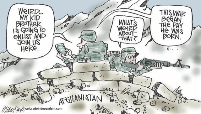 Two soldiers in Afghanistan.  One, looking at his smart phone, says,