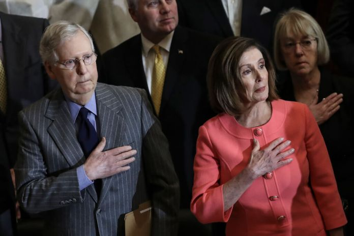 WASHINGTON, DC JANUARY 15: (L-R) Speaker of the House Nancy Pelosi and Senate Majority Leader Mitch McConnell stand for the presentation of colors during a Congressional Gold Medal ceremony at the U.S. Capitol on January 15, 2020 in Washington, DC. (Photo by Drew Angerer/Getty Images)