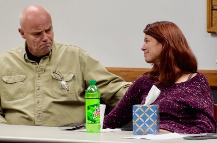 Former Rangely police Lt. Roy Kinney and Debra Pierce, widow of Daniel Pierce, a mentally ill man whom Kinney shot and killed in a 2018 police chase, share an emotional moment during a community conversation in Rangely on Dec. 2, 2019. Pierce told Kinney she does not blame him for her estranged husband's death. (Photo by Caitlin Walker)