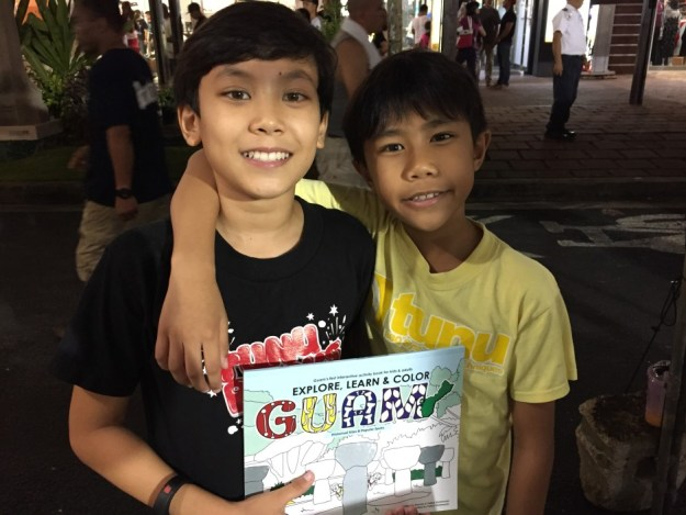 A couple satisfied customers at Guam's Big BBQ Block Party in July 2015