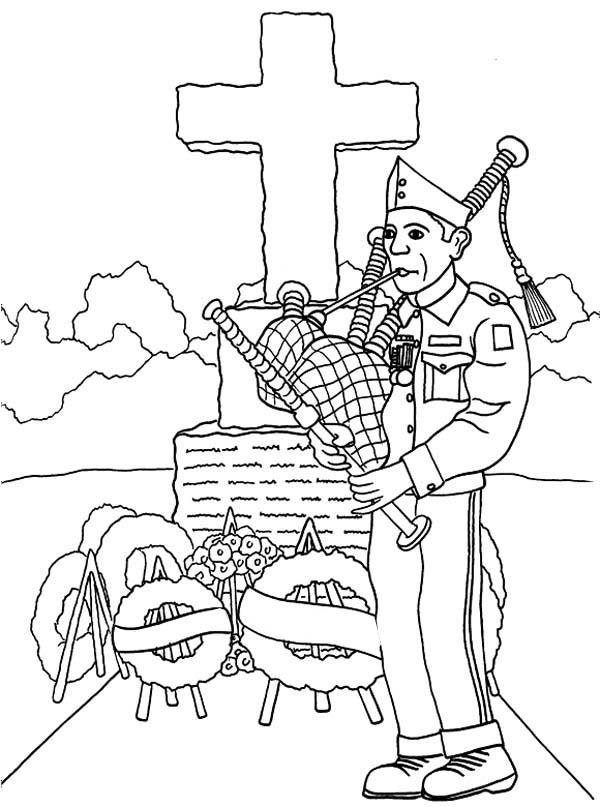 Veteran Playing Bagpipe In Cemetary Celebrating Veterans